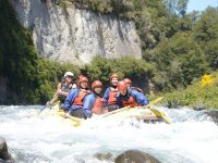 Rafting by a cliff face on the Tongariro