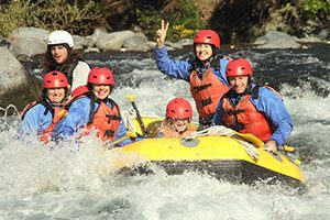 Small happy family rafting